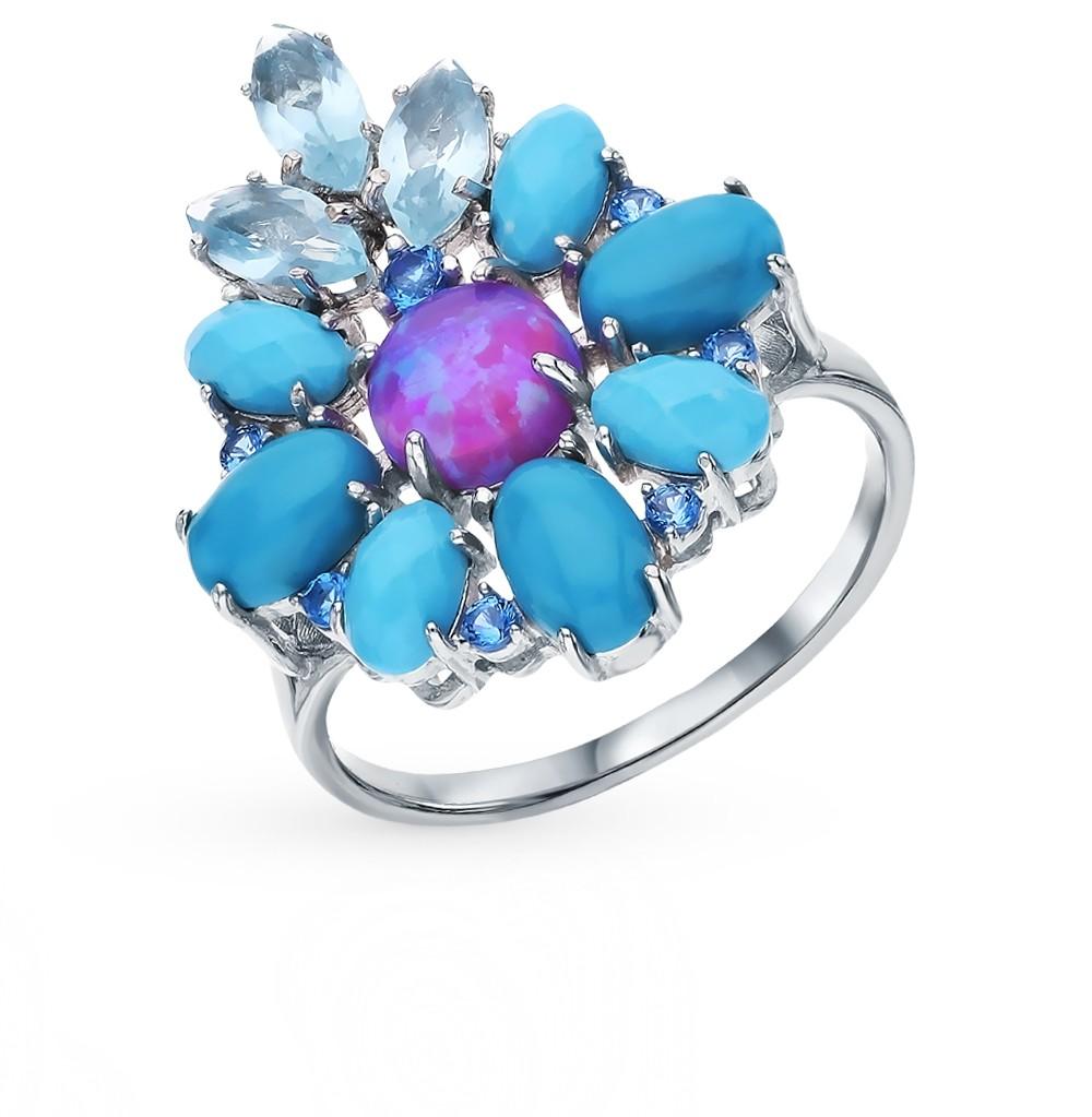 Фото «Серебряное кольцо с бирюзой, топазами, фианитами и опалами»