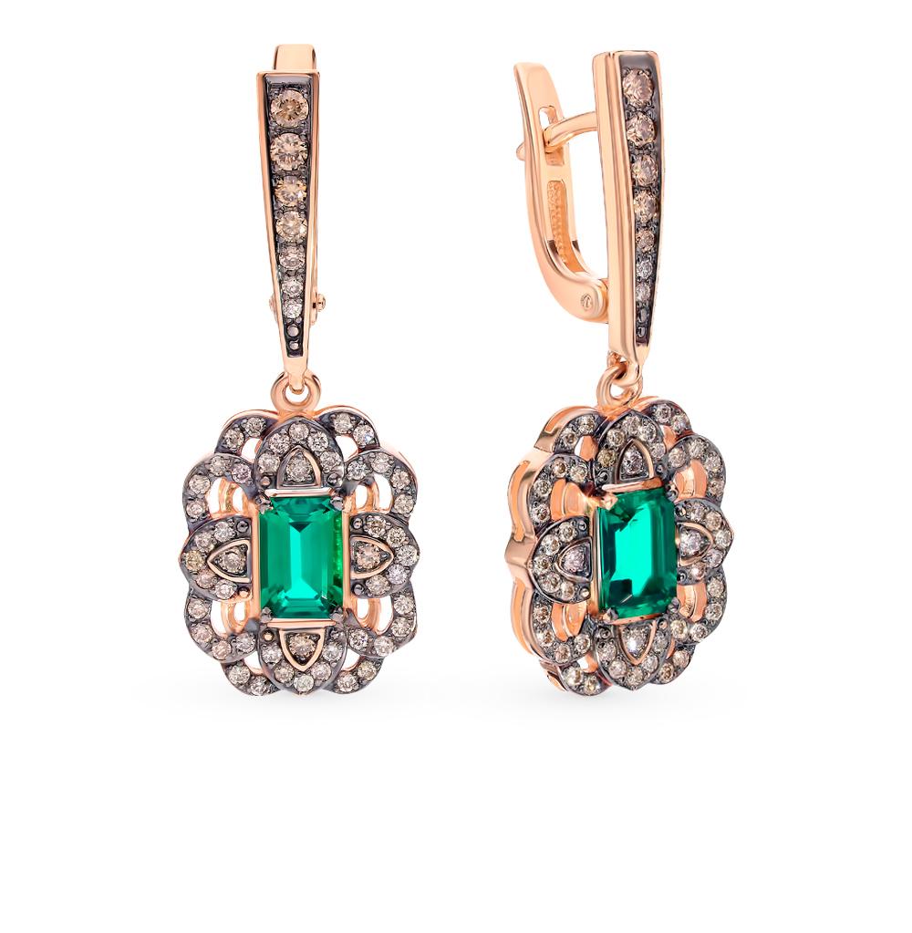 Золотые серьги с коньячными бриллиантами и изумрудами в Екатеринбурге