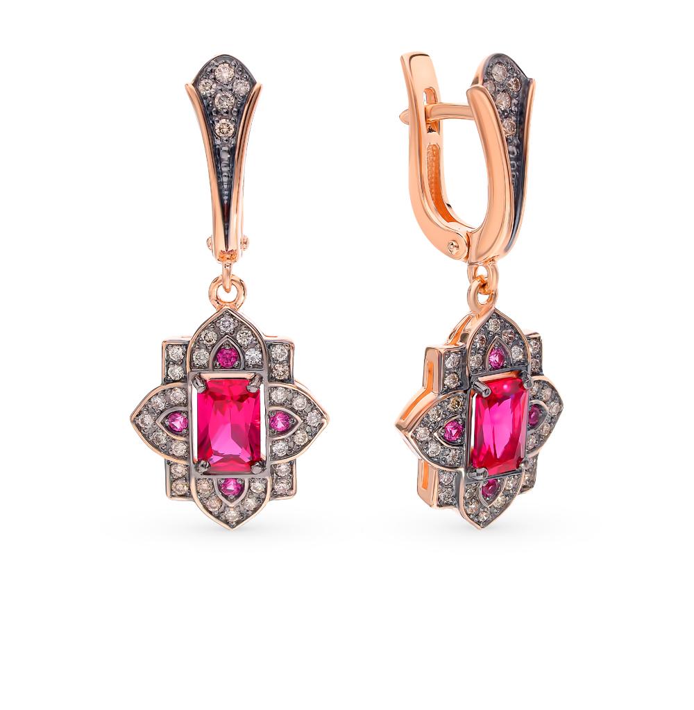 Фото «Золотые серьги с коньячными бриллиантами и рубинами»