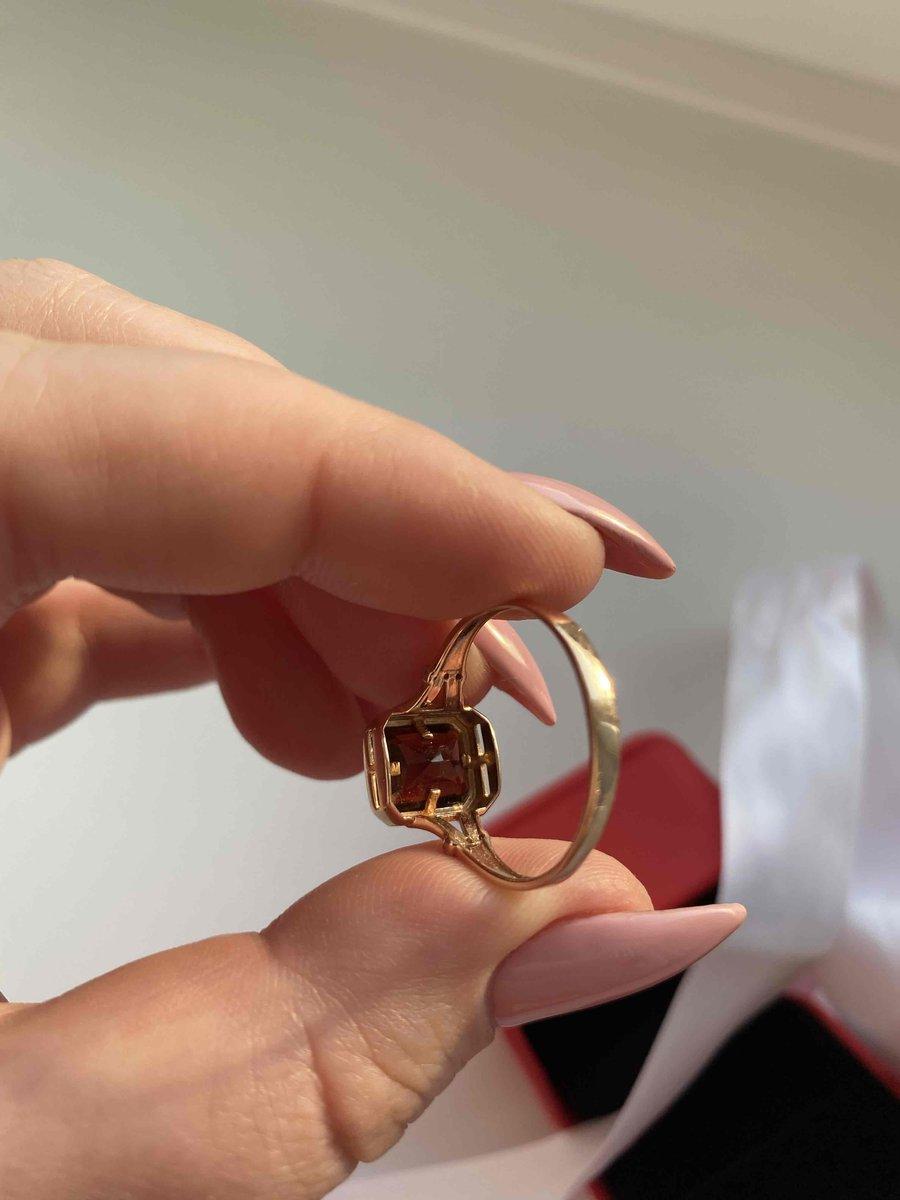 Золотое кольцо с топазом и гранатом
