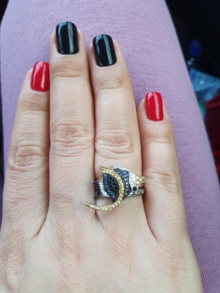 Оригинальный комплект,  серьги+ кольцо,  смотрится круто,  рекомендую.